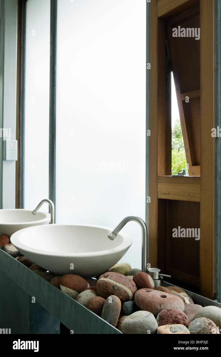 Modern washbasins by frosted glass windows - Stock Image