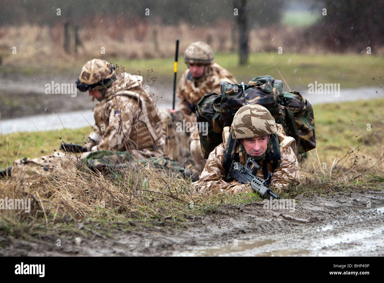 British soldiers wearing desert camouflage uniforms in training for deployment to Afghanistan prepare to destroy - Stock Image