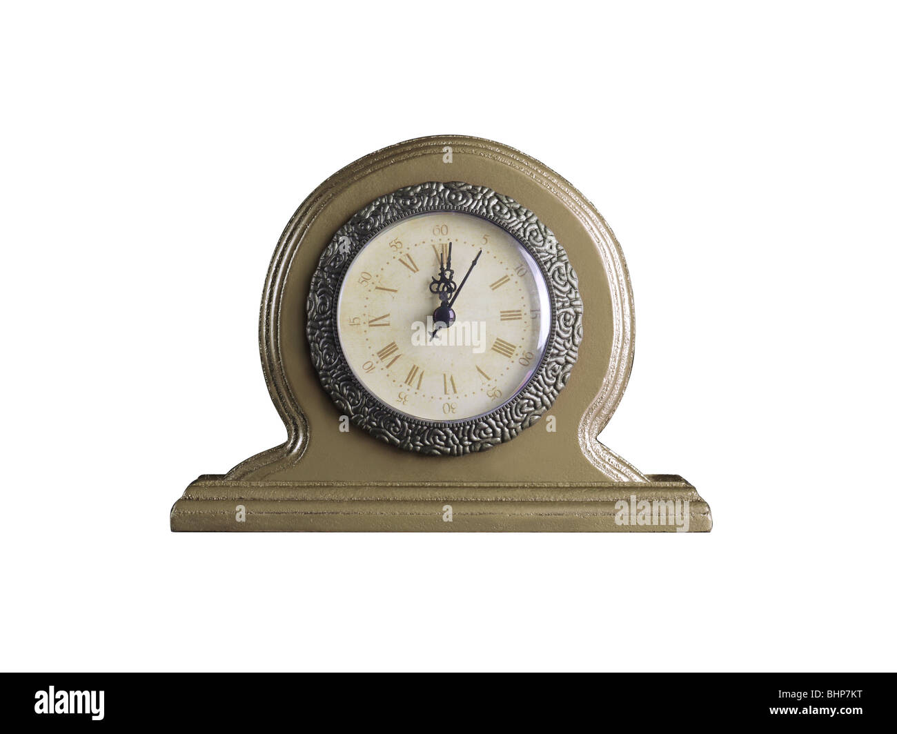 Golden table clock showing twelve o'clock isolated on white background - Stock Image