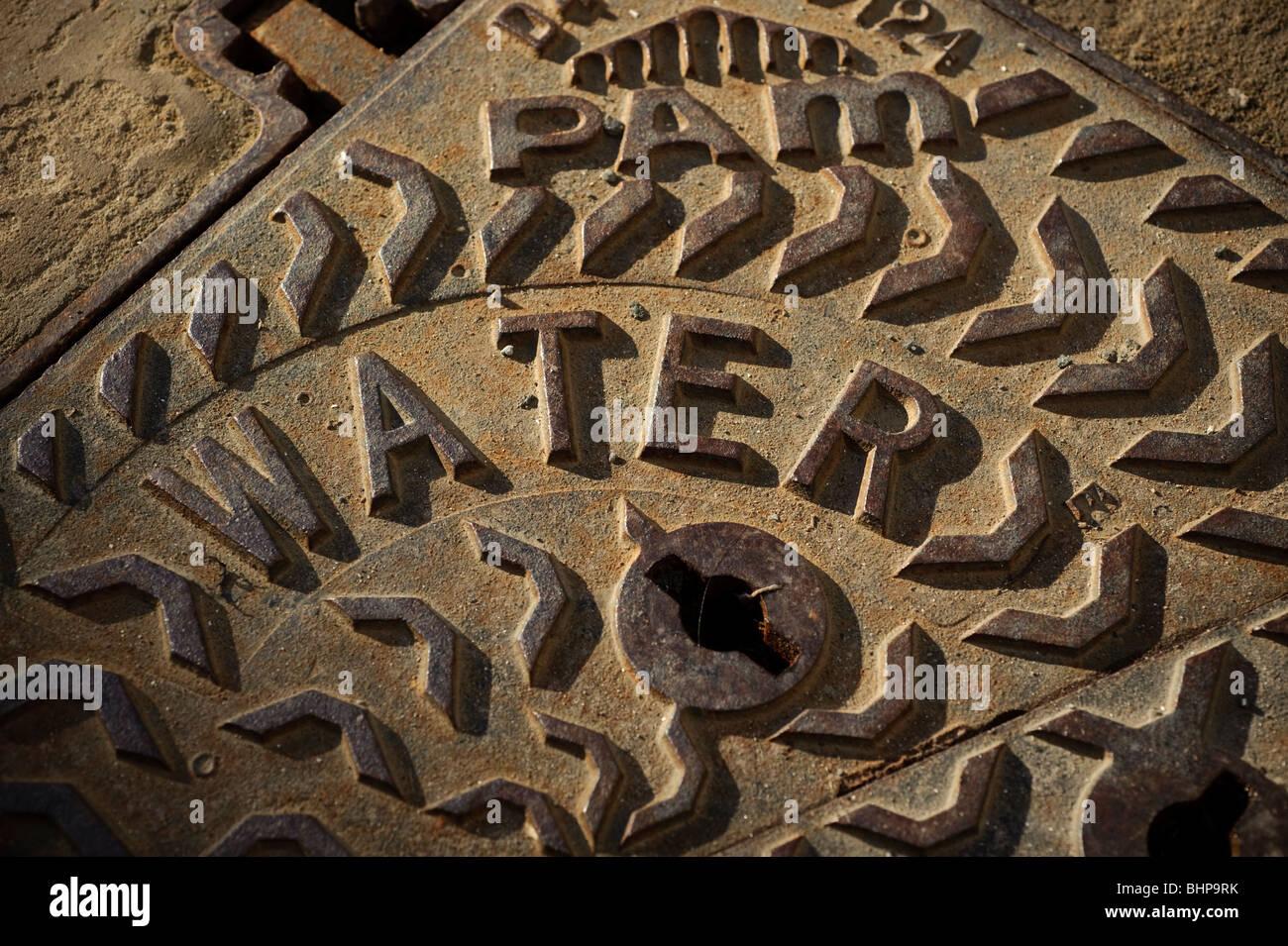 Water main cast iron manhole cover, UK - Stock Image