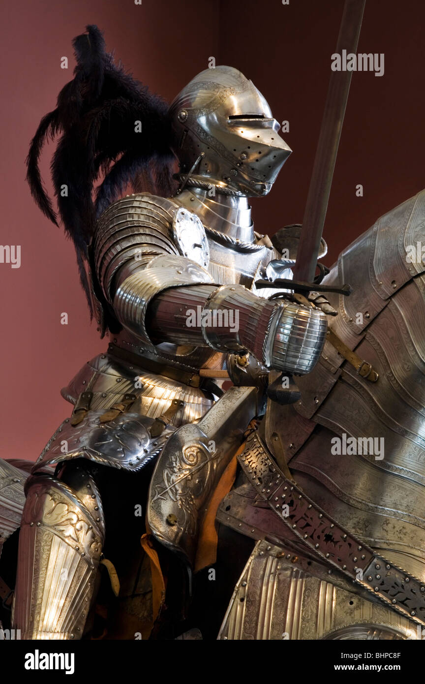 Feathered helmet and horse armor. Classic Medieval Full Suit of Armor. - Stock Image