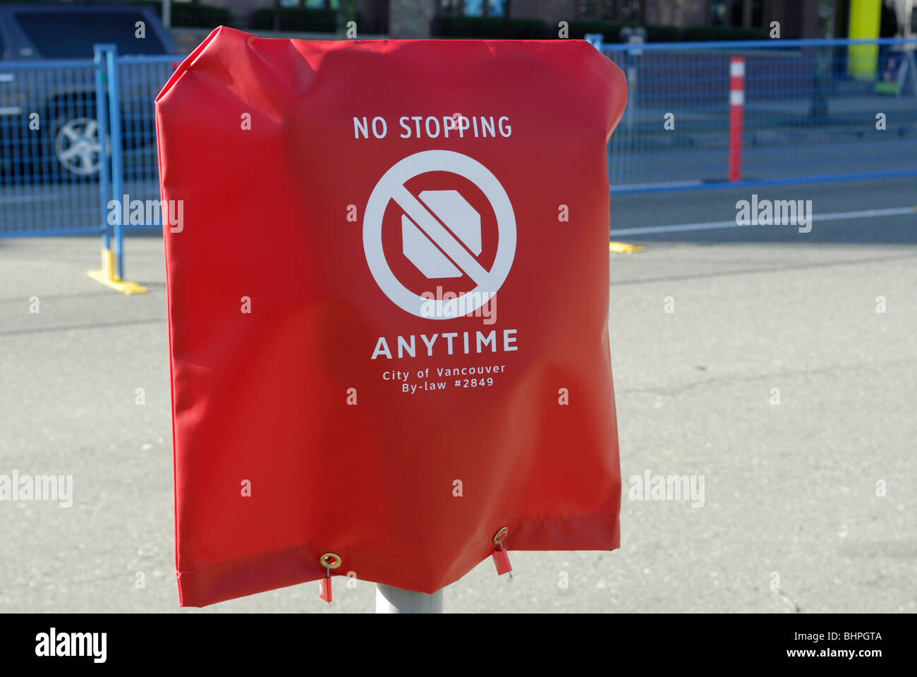 Street meter cover warning motorists that no parking or stopping is in effect. - Stock Image