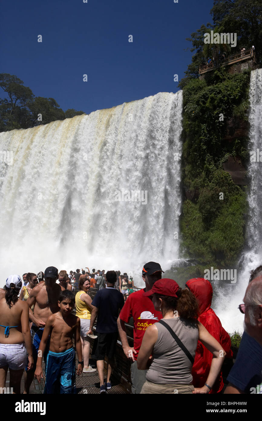 tourists at viewpoint underneath the adan y eva adam and eve fall on the lower circuit in iguazu national park argentina - Stock Image