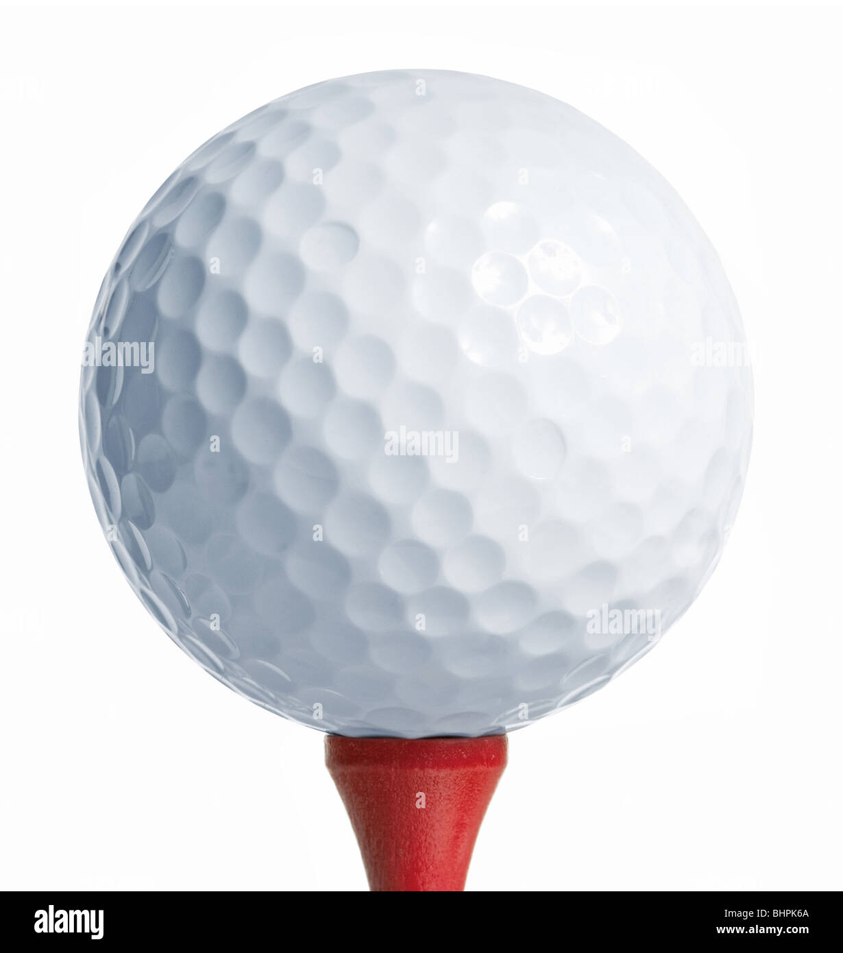 Golfball on a red tee. white background - Stock Image
