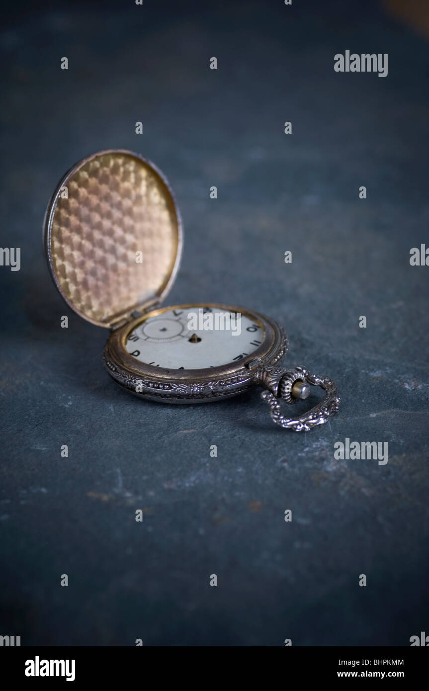 Antique pocket watch on the ground - Stock Image