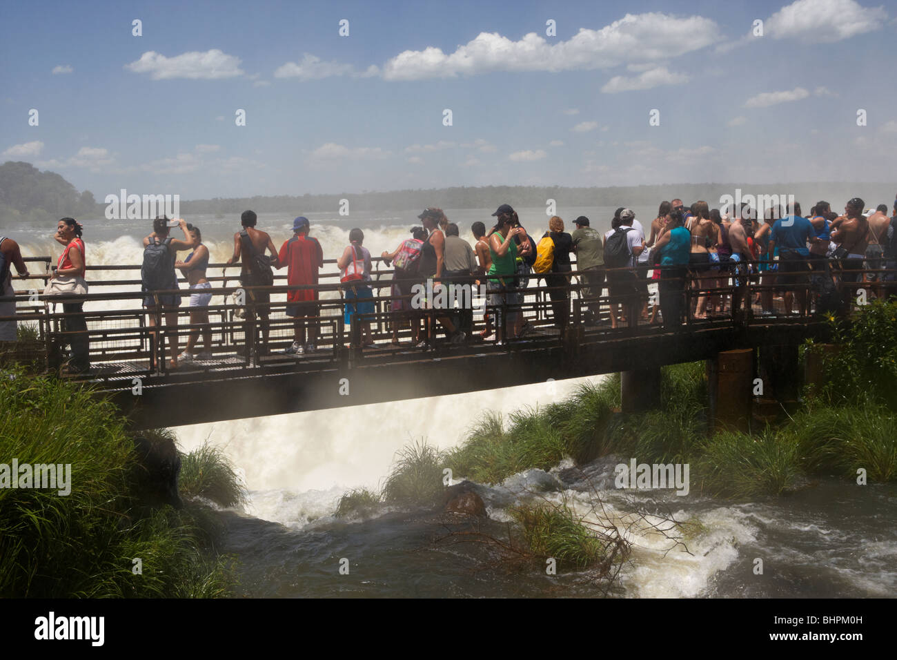 tourists on the devils throat circuit trail walkway in iguazu national park, republic of argentina, south america - Stock Image