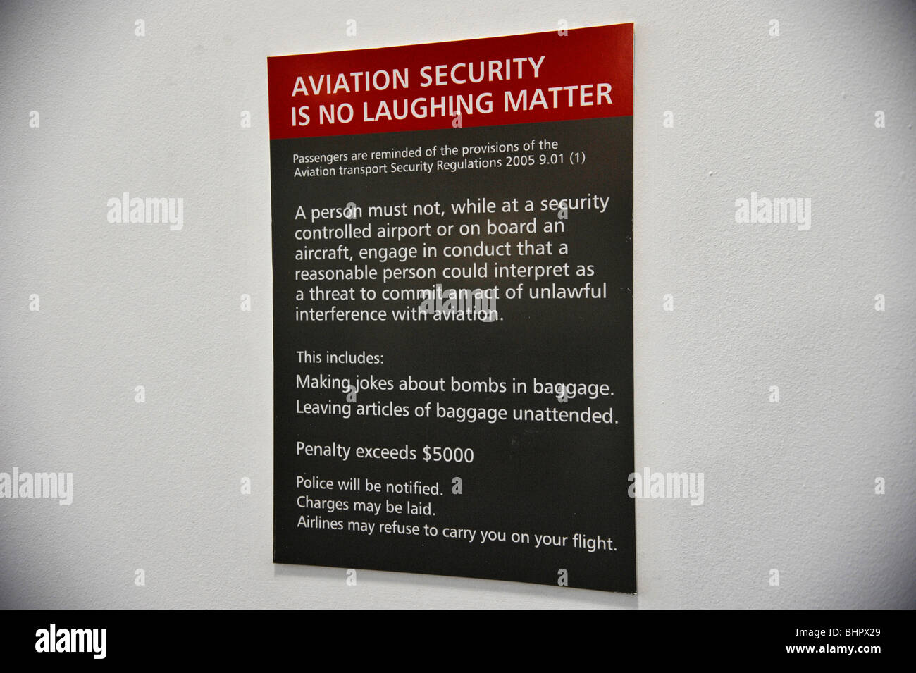 Aviation Security sign about laughing at Airline security. - Stock Image