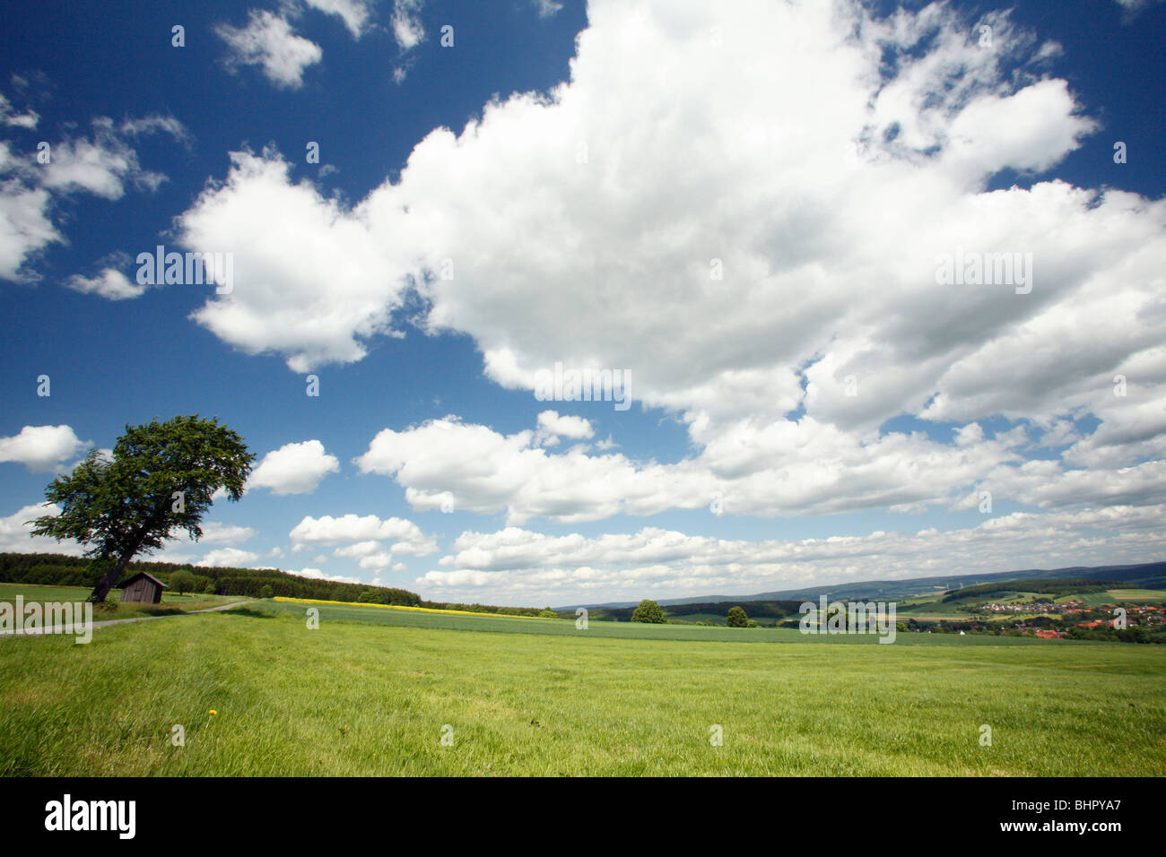 Cumulus Clouds, over hill farmland, Hessen, Germany - Stock Image