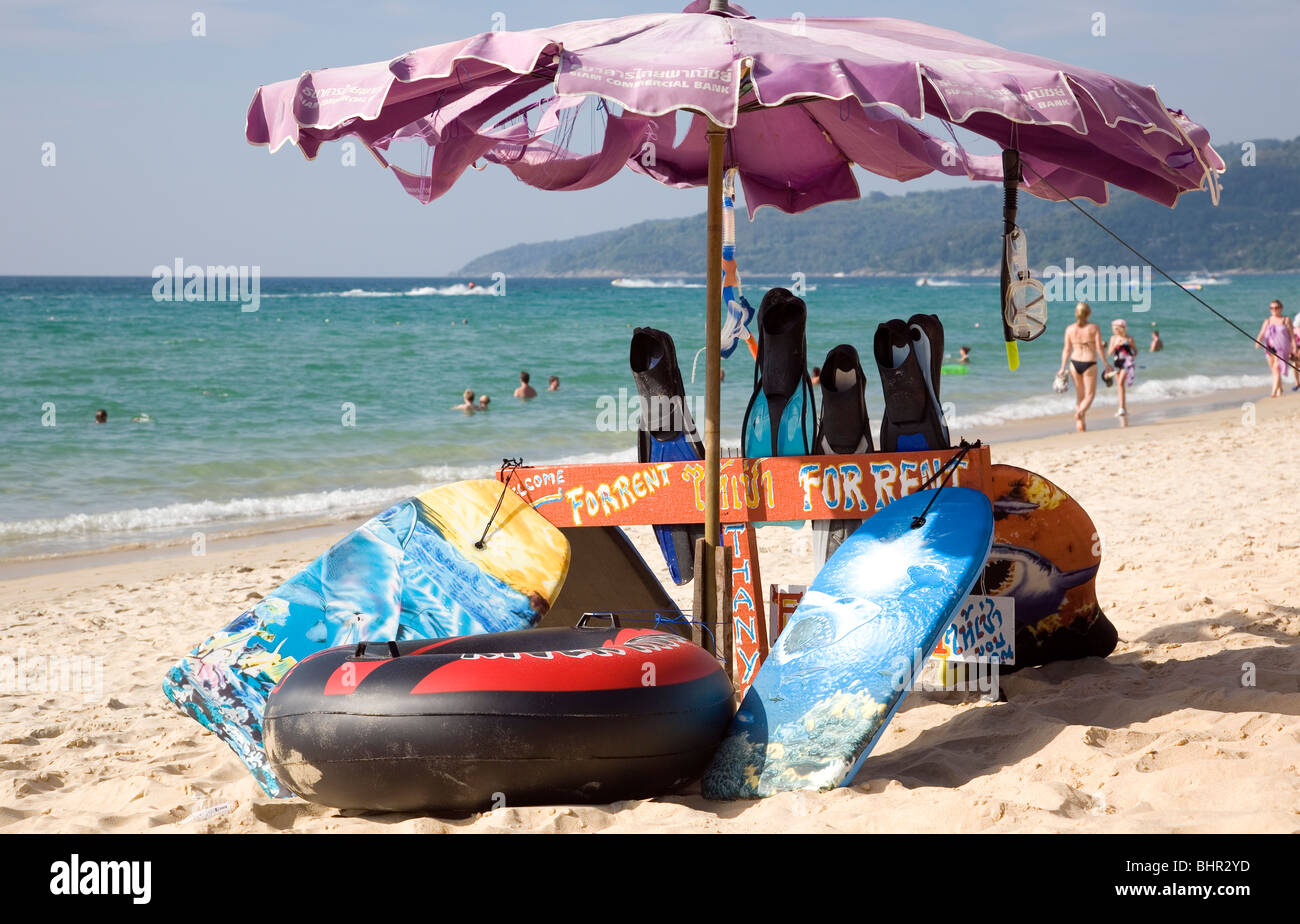 Swimming boards and rings for rent on Karon Beach Phuket - Stock Image