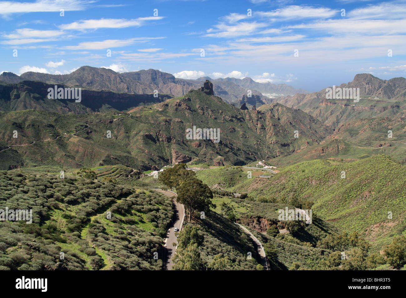 View towards Roque Bentayga near Tejeda from ridge footpath near Cruz de Tejeda (1500m) on Gran Canaria. Stock Photo