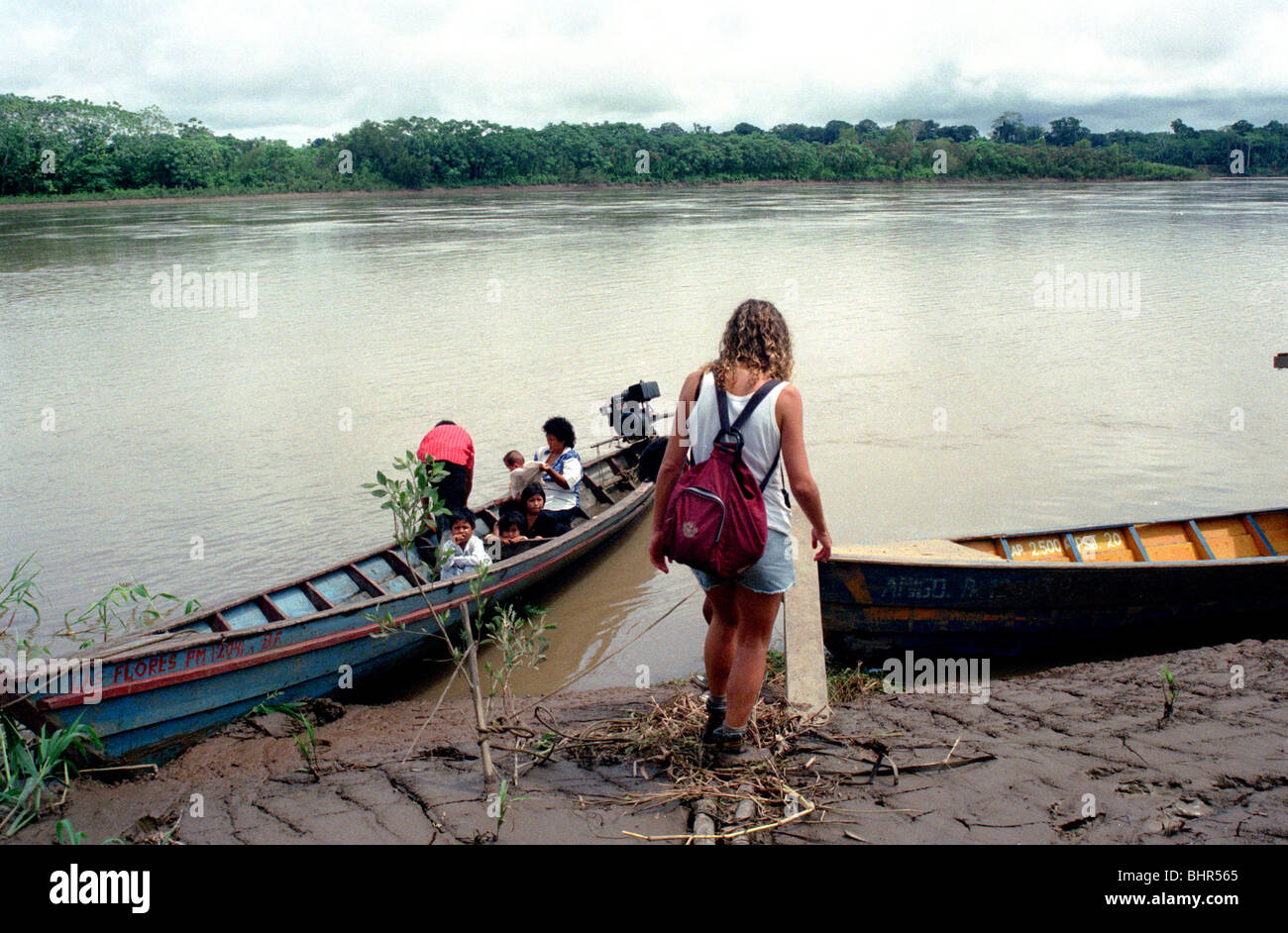 tourist boards canoe in the Peruvian Amazon - Stock Image