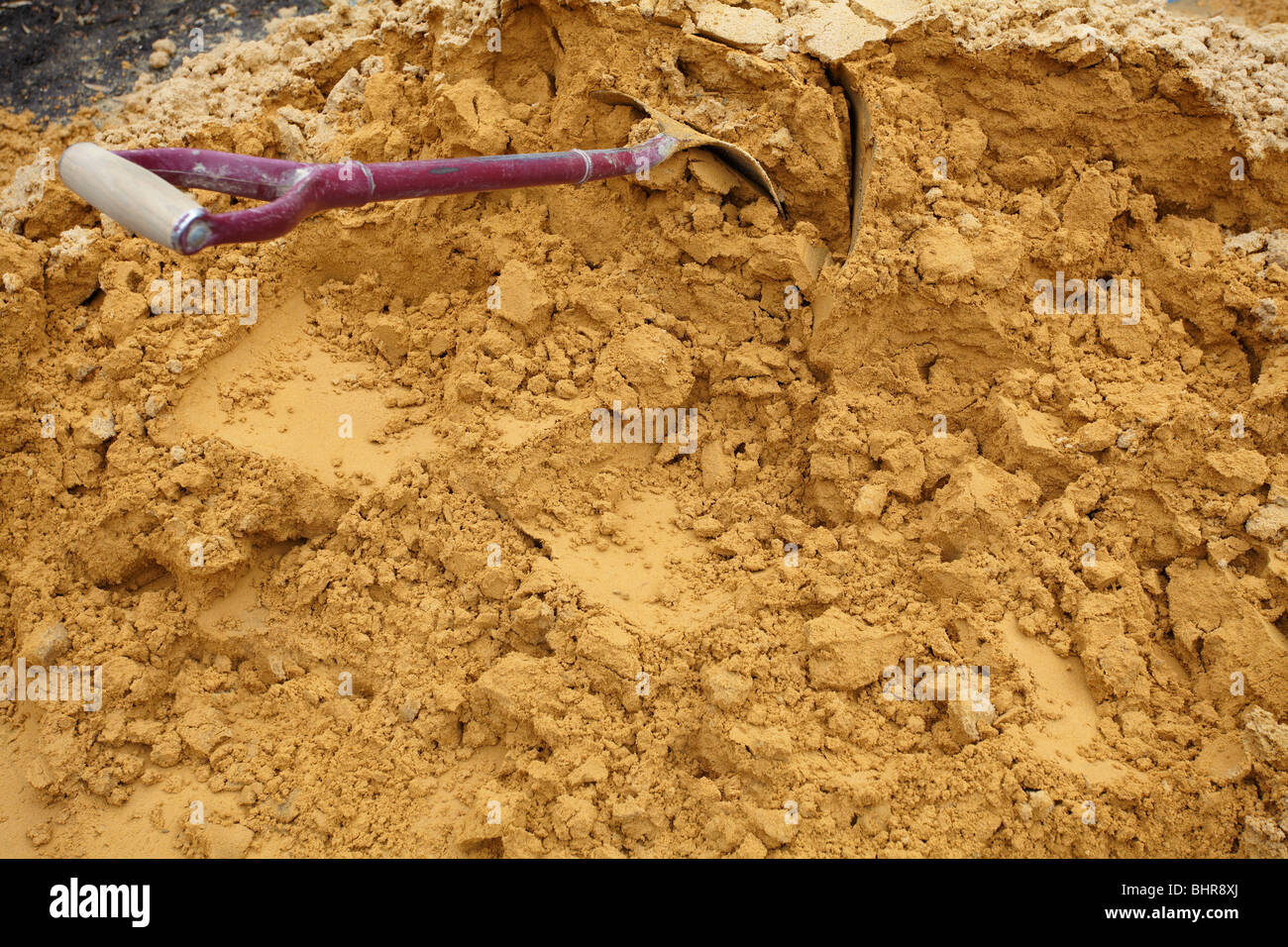 Building Sand with spade detail - Stock Image
