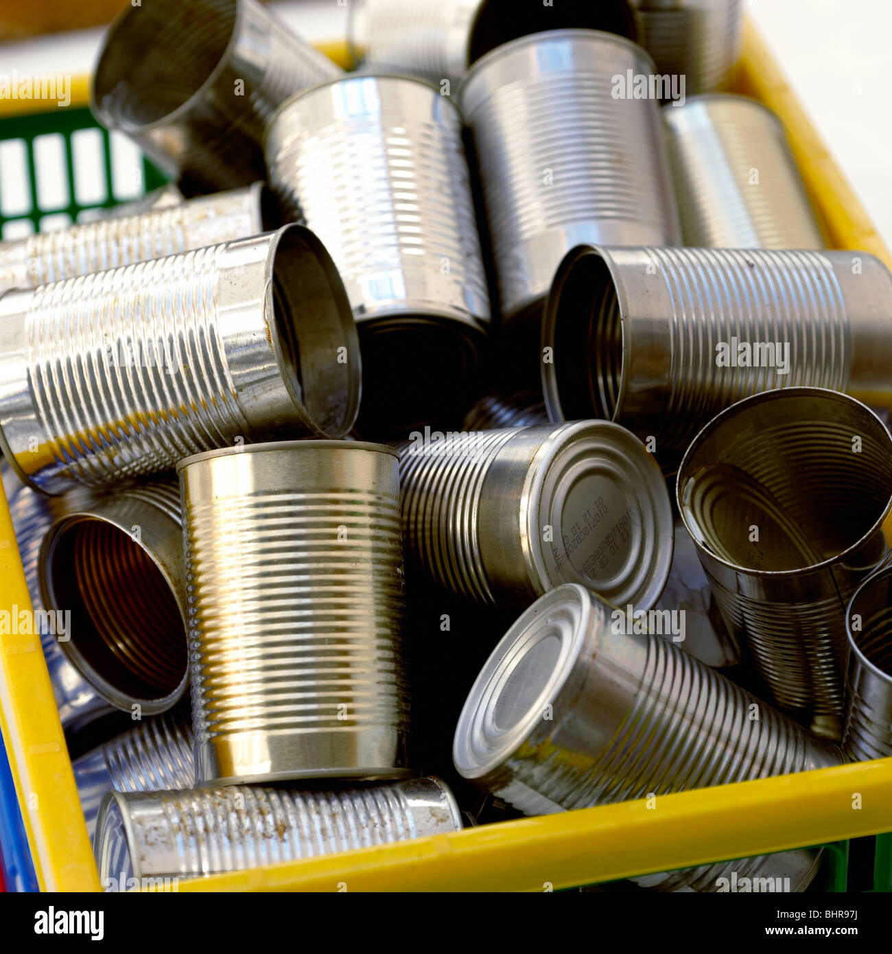 Tin cans in a recycling box - Stock Image