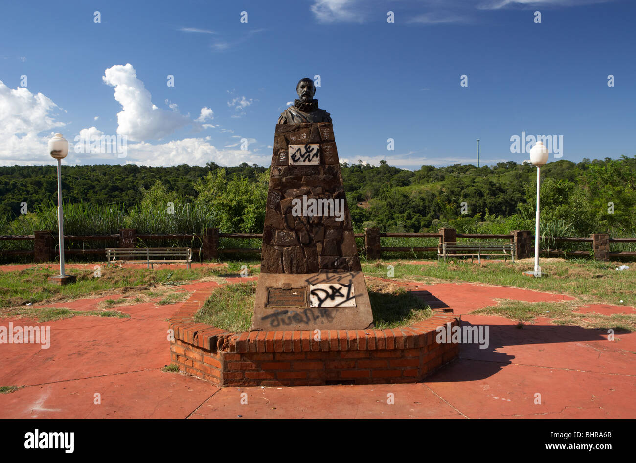 statue and bust of spanish explorer alvar nunez cabeza de vaca defaced with grafitti in puerto iguazu argentina - Stock Image