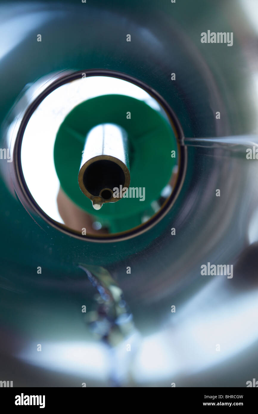 Petrol trickling down a petrol pipe from a pump - Stock Image