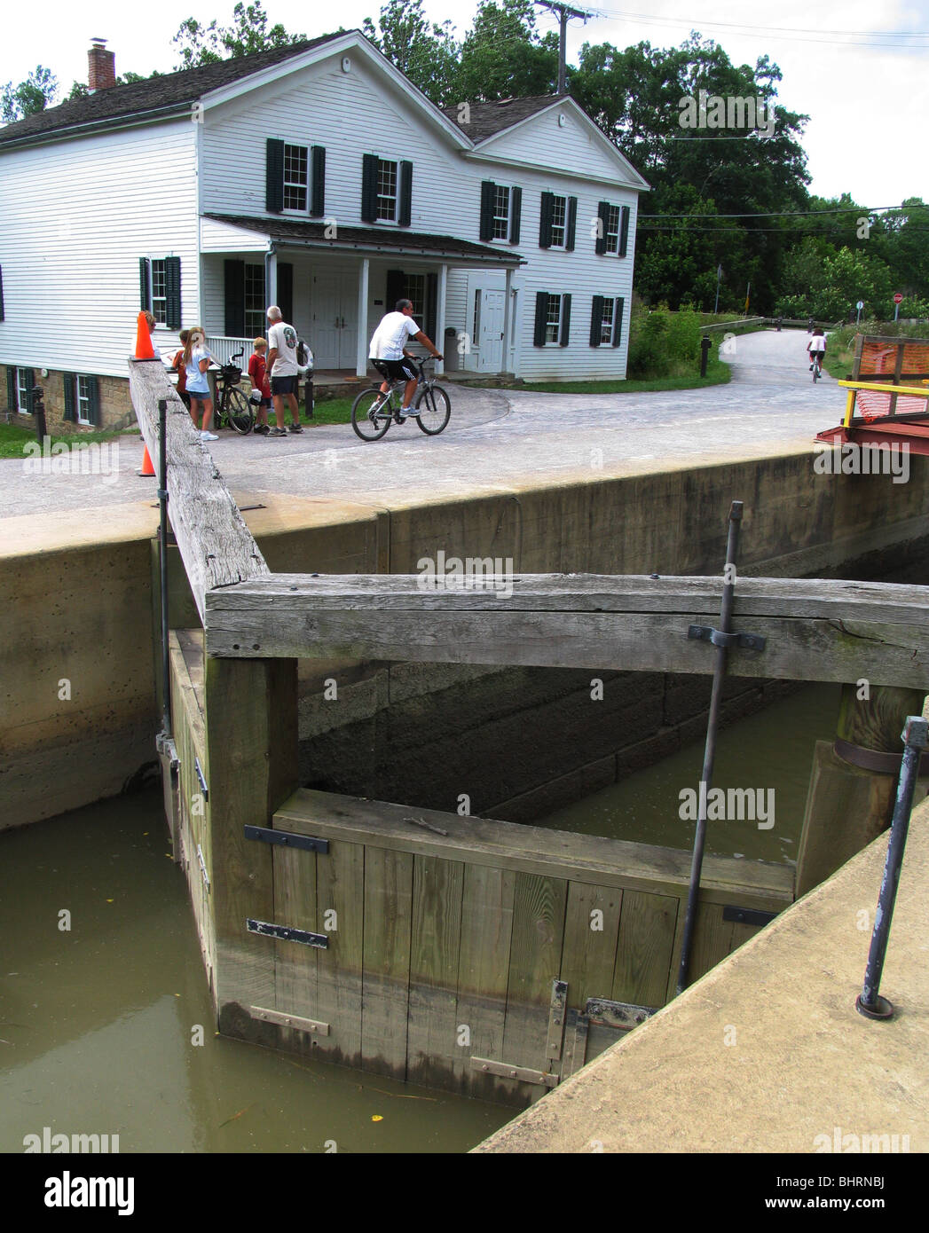 Canal lock Ohio and Erie Canal Towpath Trail bikers Cuyahoga Valley National Park Ohio bike path hike history historic - Stock Image