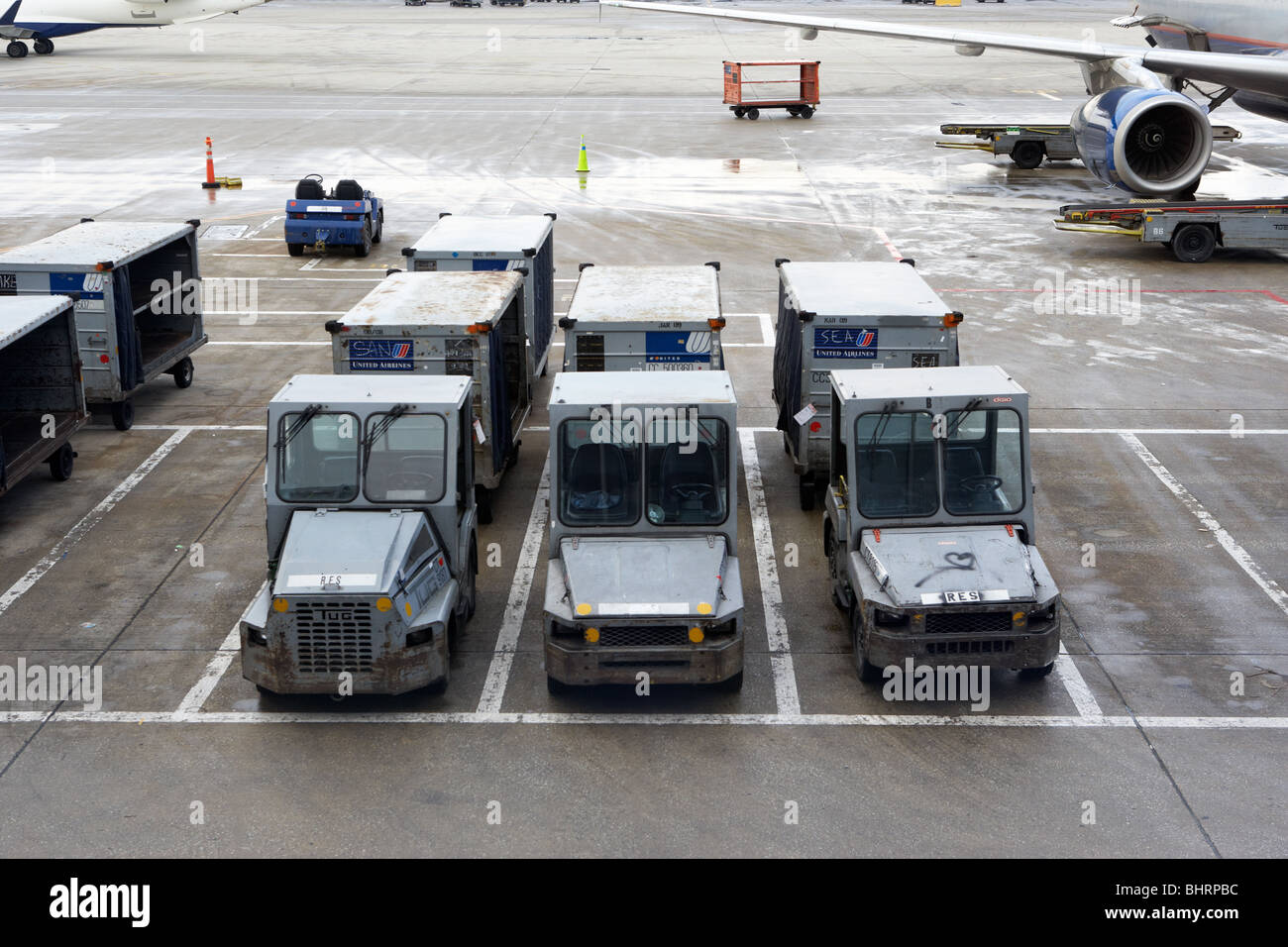 united airlines luggage cars carts parked on a cold wintry day at o'hare international airport chicago usa - Stock Image