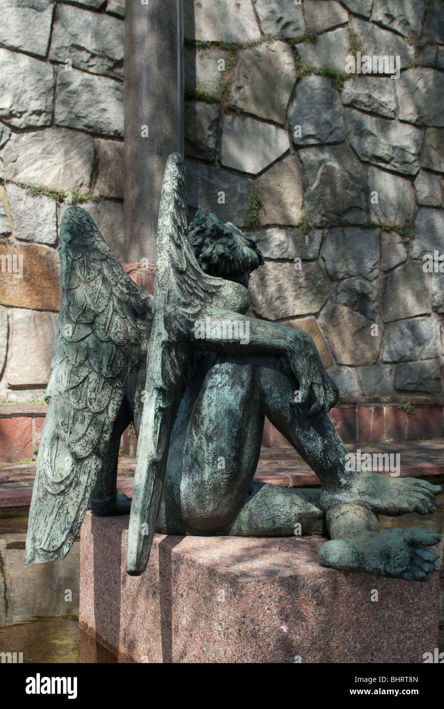 a sculpture of an angel sitting at st. martins fountain in millesgarden - Stock Image