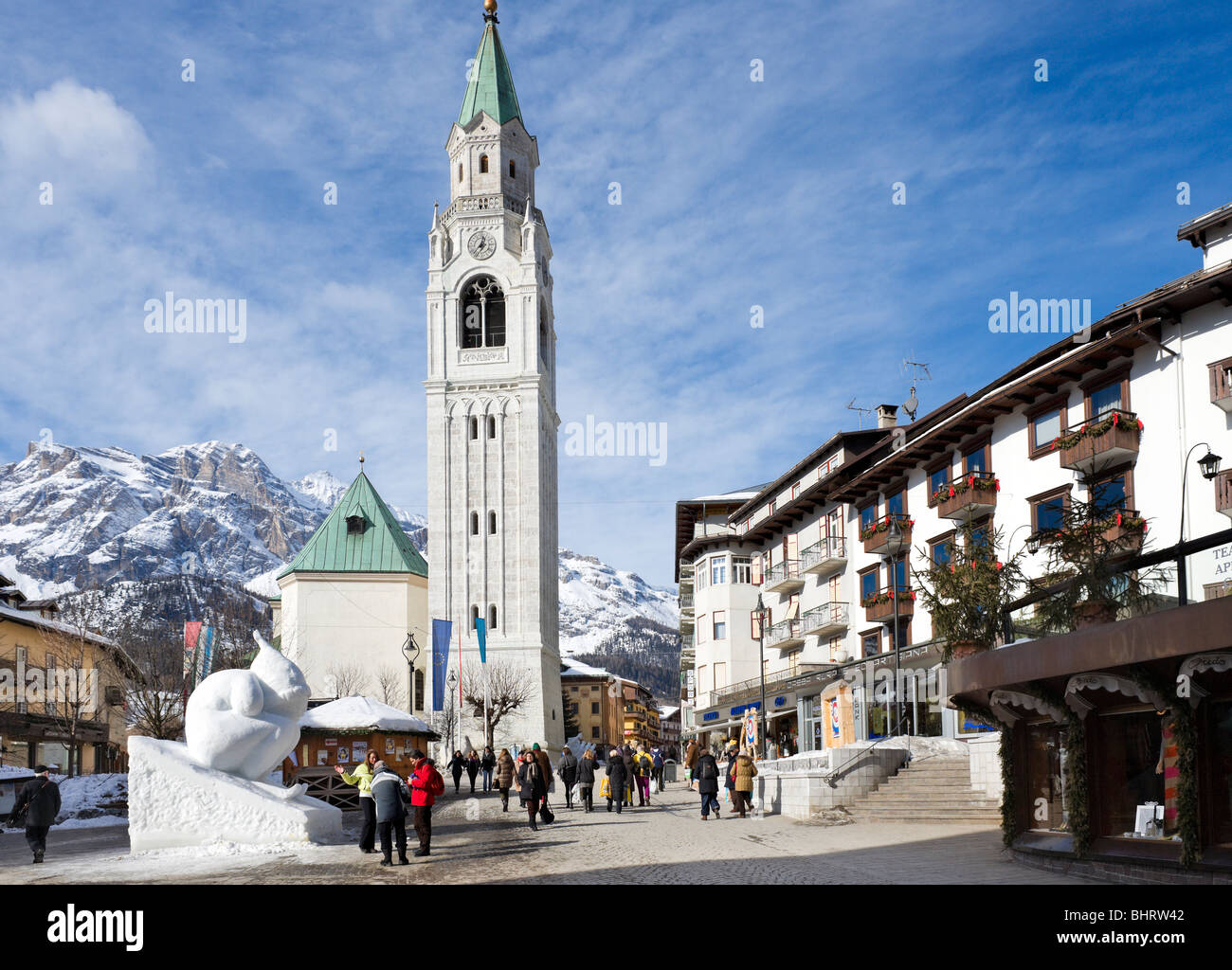 Snow sculpture in front of the church on Corso Italia, Cortina d'Ampezzo, Dolomites, Italy - Stock Image