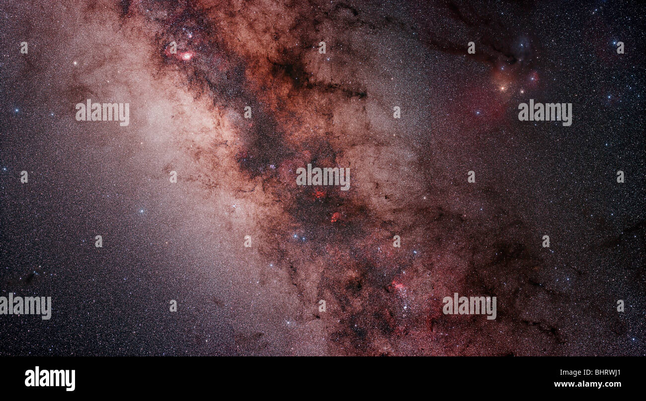 Stars, nebulae and dust clouds around the center of the Milky Way. - Stock Image
