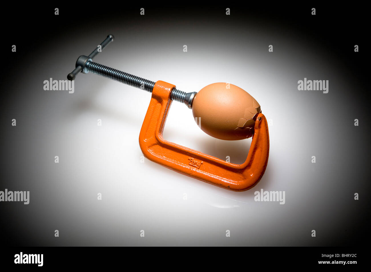 C-Clamp and Egg - Stock Image
