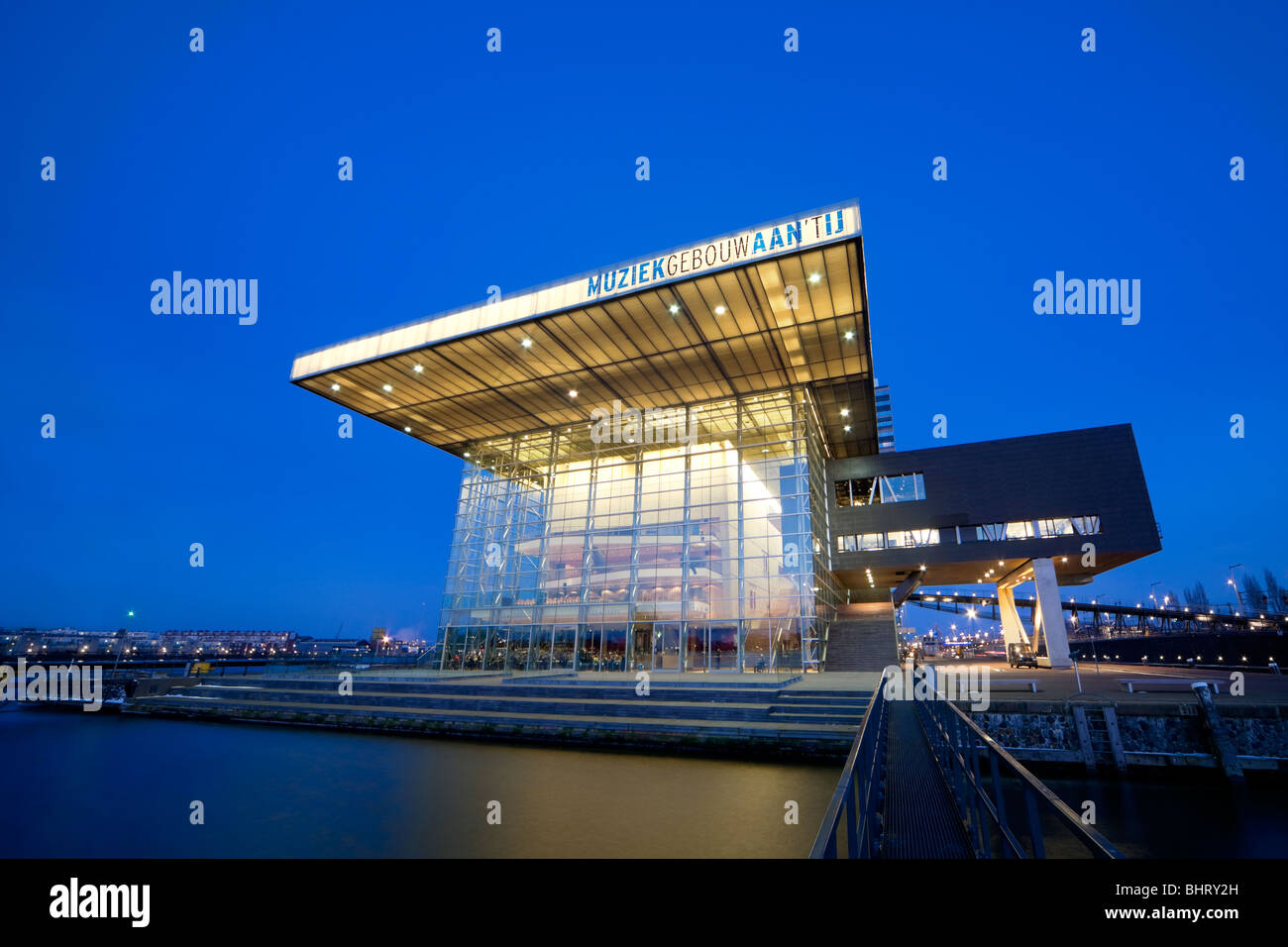 Amsterdam Muziekgebouw aan 't IJ, Music Building at the IJ, the BIMhuis and the Star Ferry Restaurant at dusk. - Stock Image