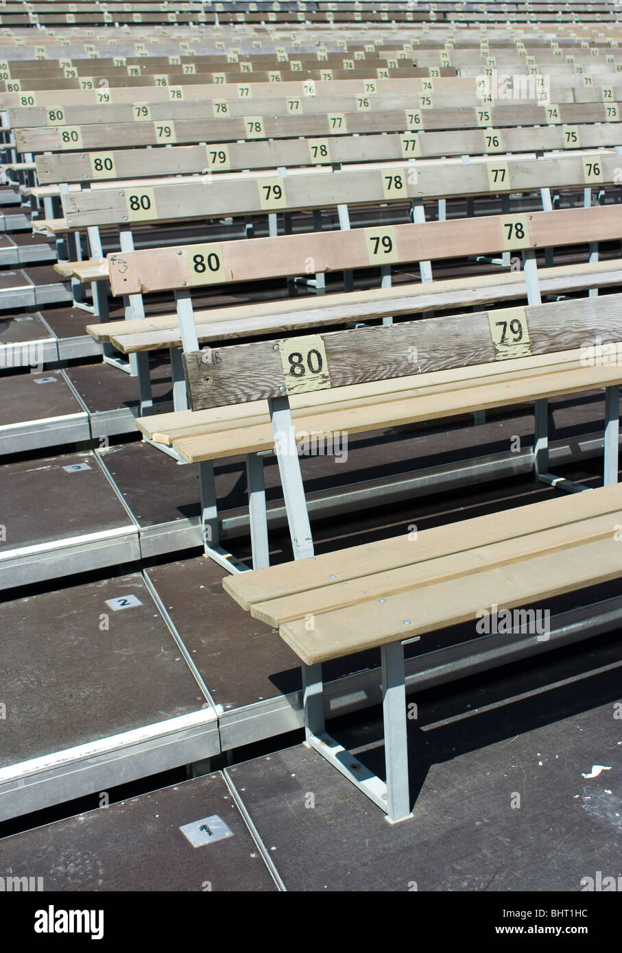 Rows of benches in an outdoor arena - Stock Image