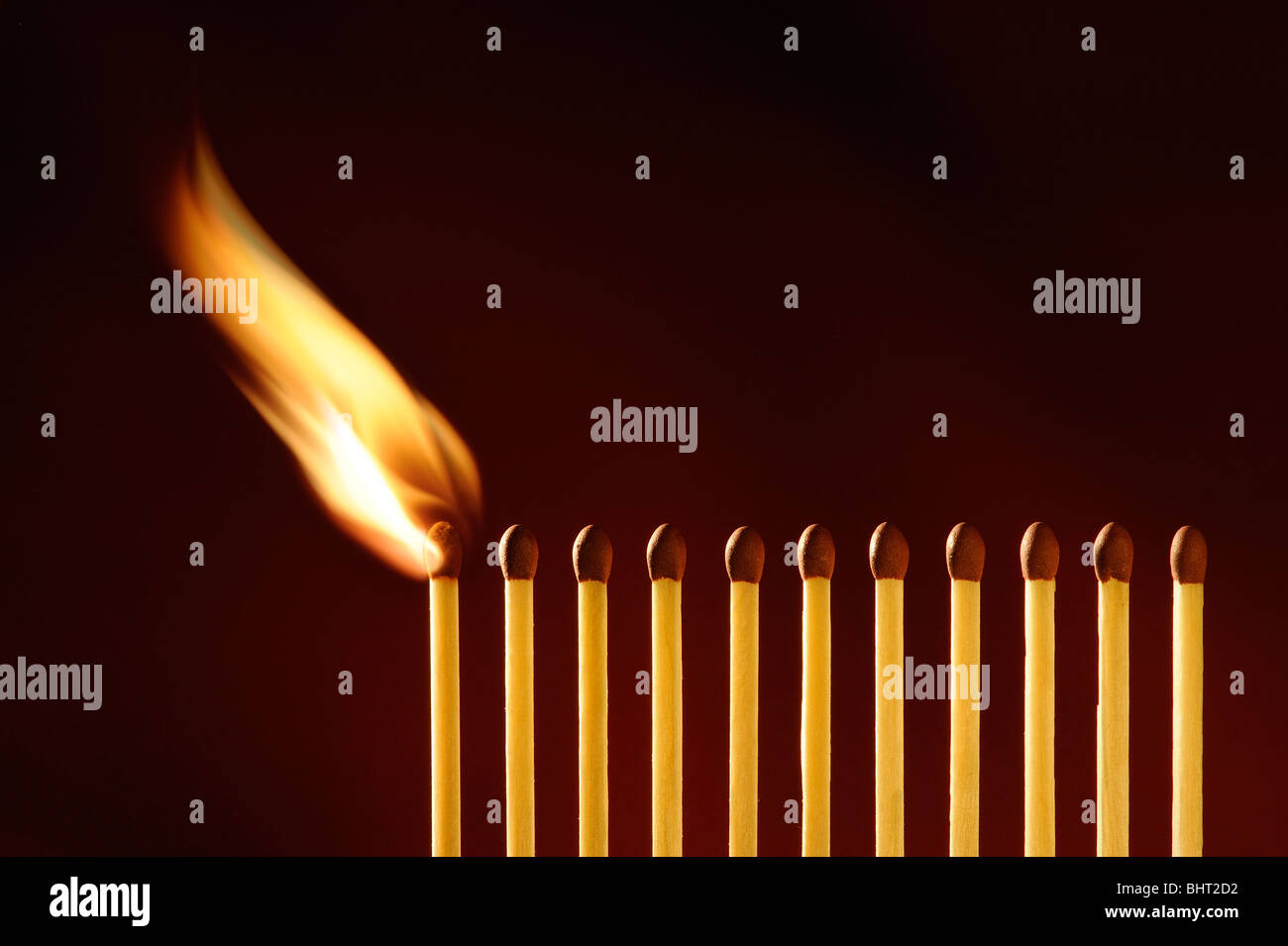 A line of matches igniting - Stock Image