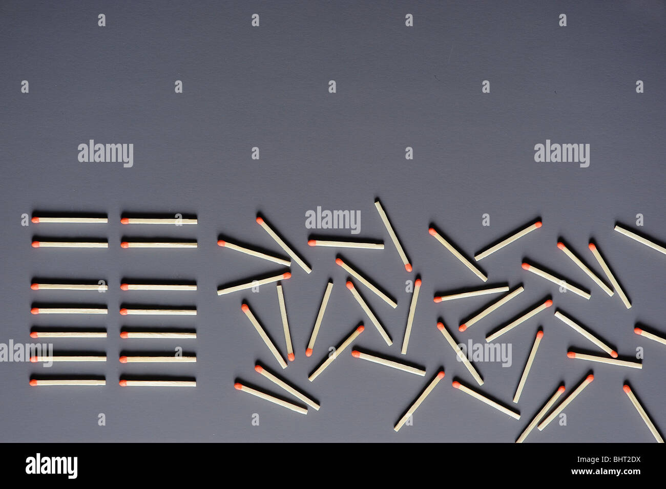 Matches lined up and scattered on a surface Stock Photo