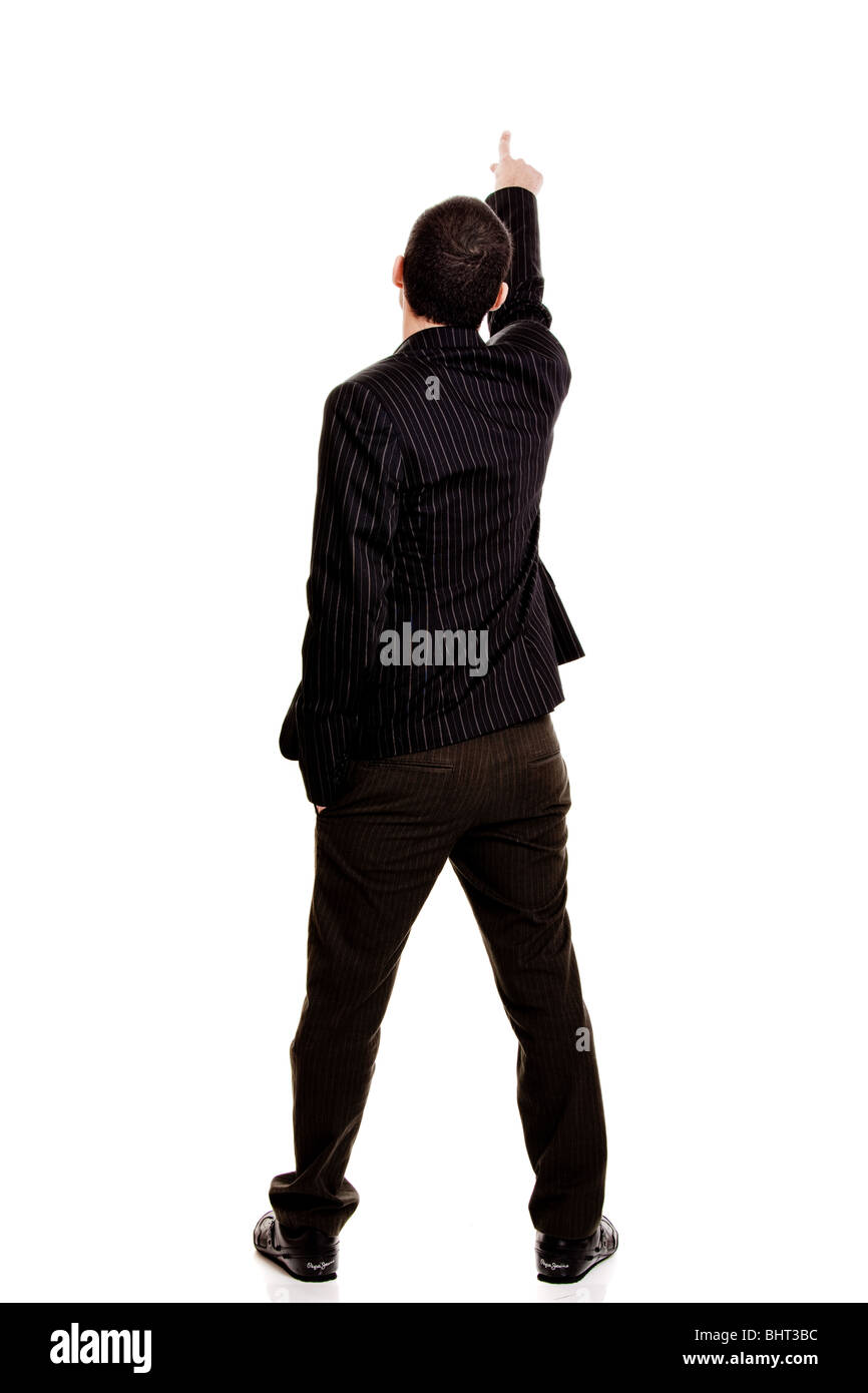 Back view of a businessman pointing, isolated on white background - Stock Image
