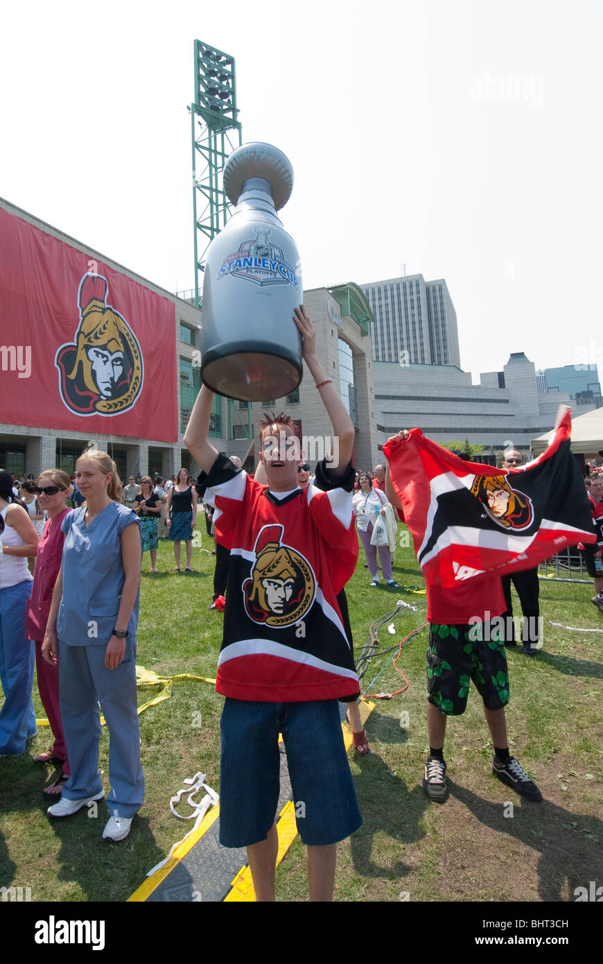 An inflatable Stanley Cup is held high by an Ottawa Senators fan at a rally  for the Stanley Cup Finals bound team May 24th 2007. 4f6013b596a4