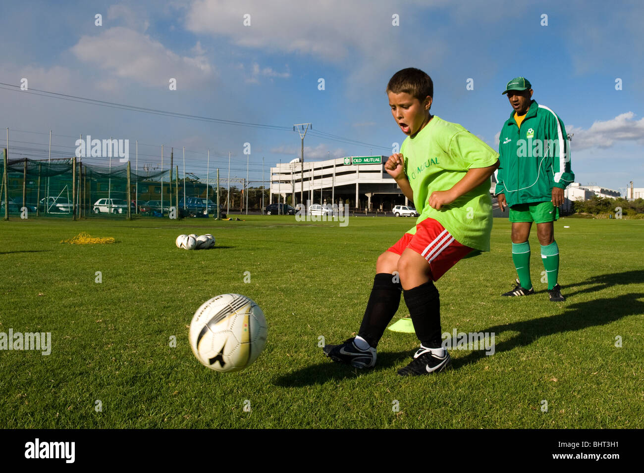 Coach watching player at Old Mutual Football Academy, Cape Town, South Africa - Stock Image