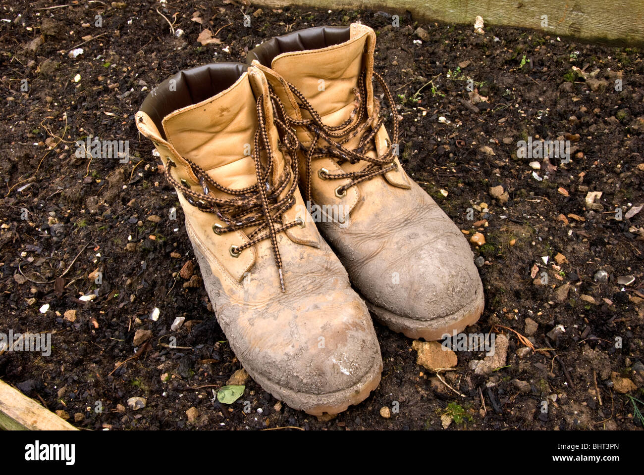 Dirty gardening boots on soil Stock Photo: 28189357 - Alamy