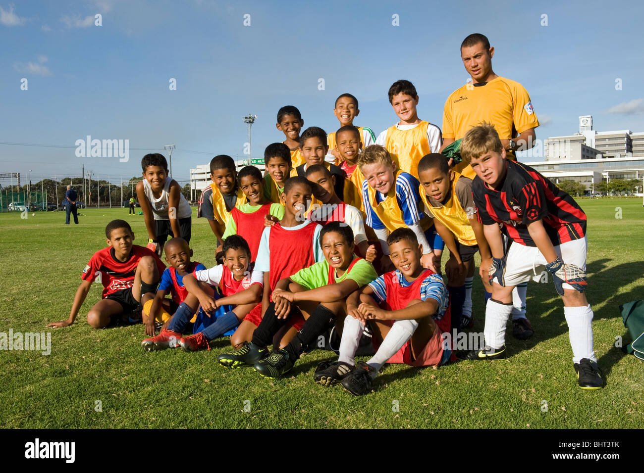 Young players with coach at Old Mutual Football Academy, Cape Town, South Africa - Stock Image