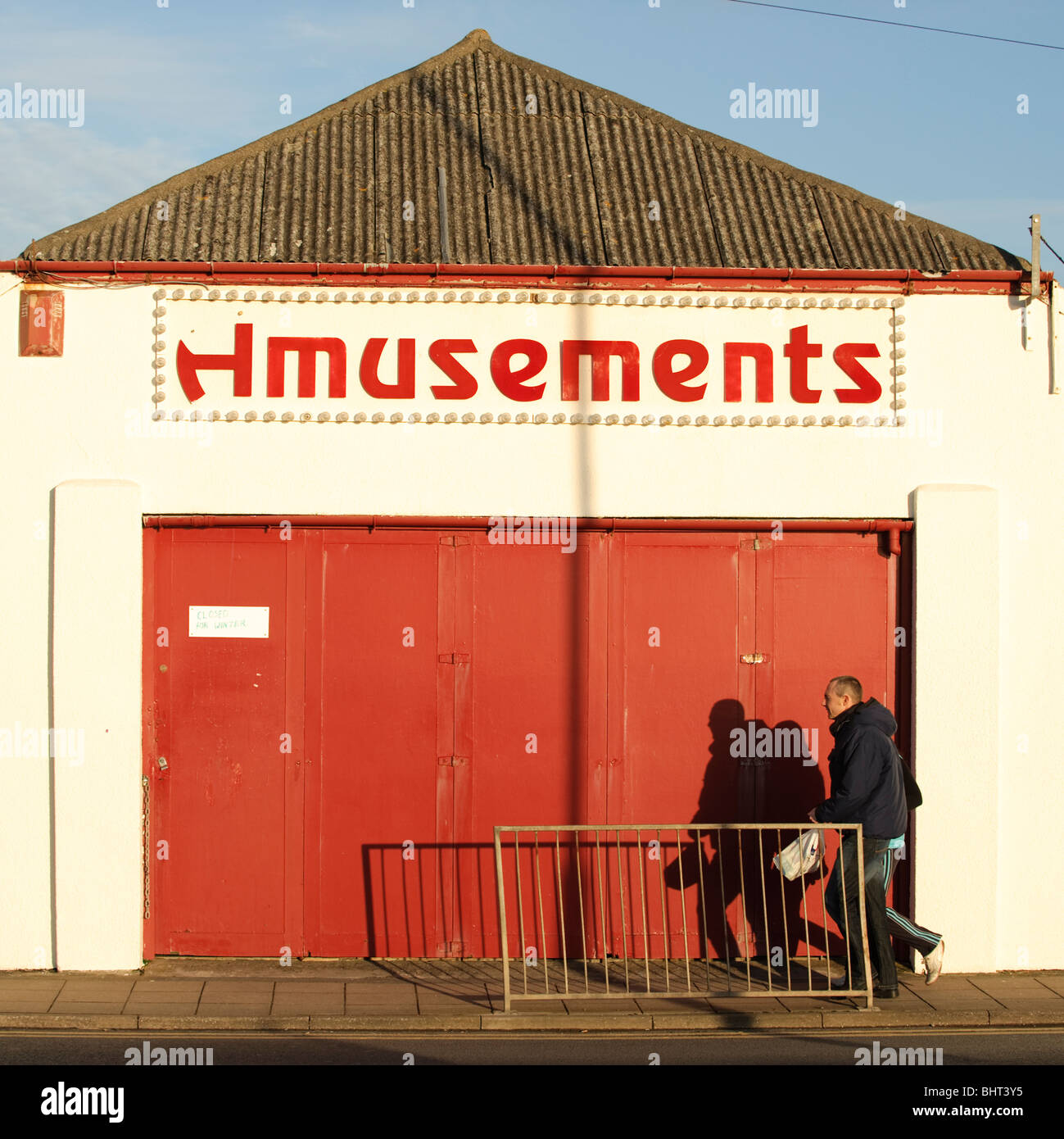 Closed amusement arcade, out of season winter, Borth, Ceredigion, Wales UK - Stock Image
