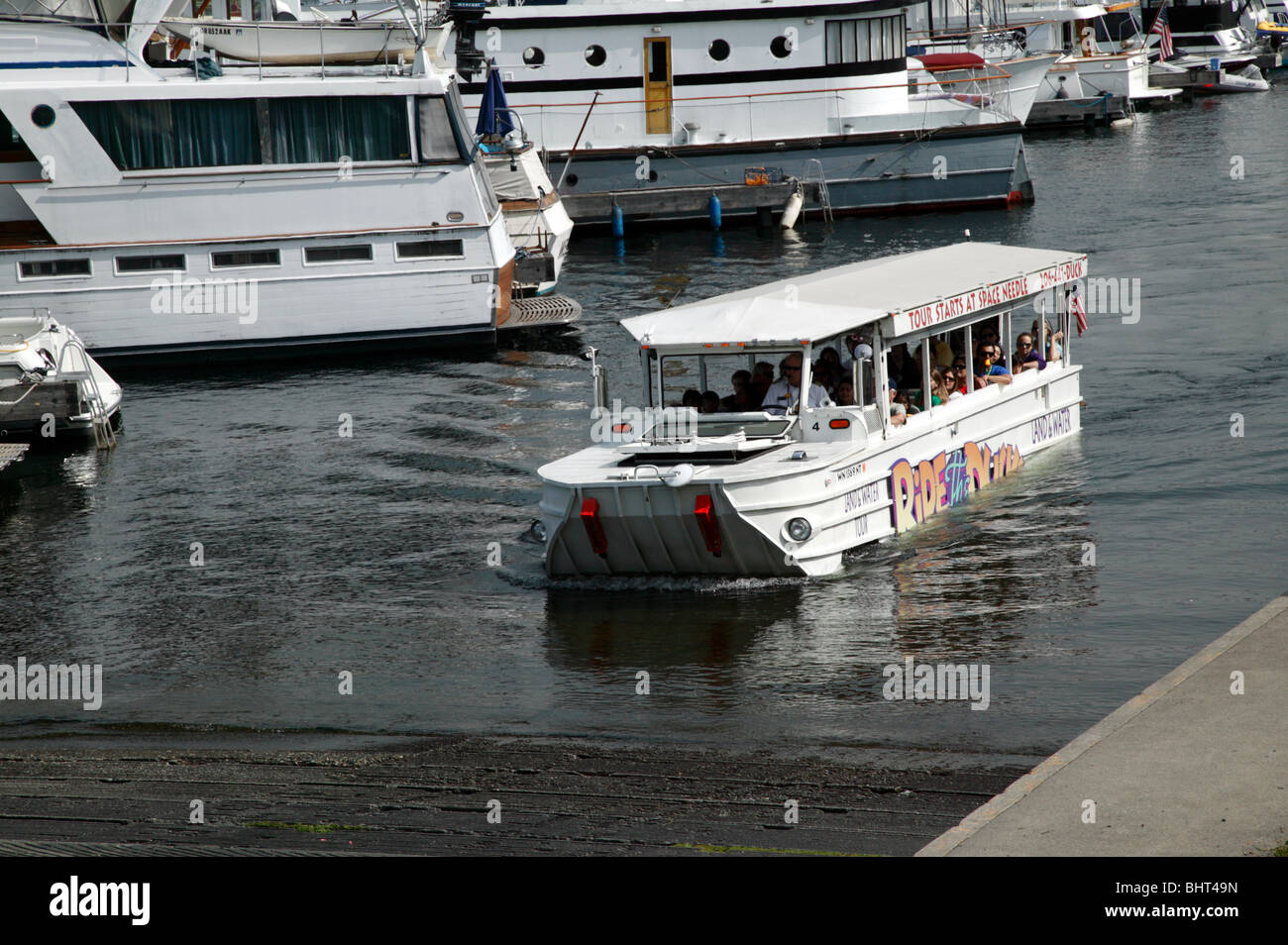 Second world War Amphibious vehicle emerges from lake Union, during a Duck tour of Seattle - Stock Image