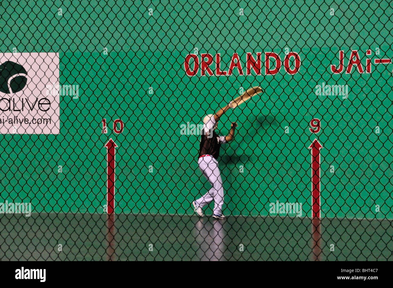 Jai alai player prepares to catch the ball (pelota) in his woven basket (cesta) at the Orlando fronton in Fern Park, - Stock Image