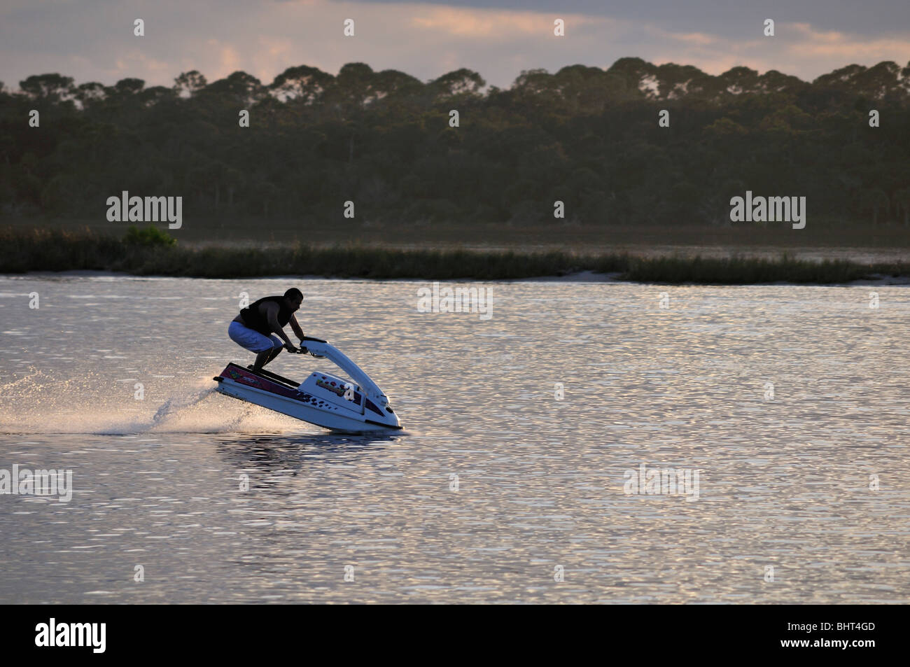 A personal watercraft plows through the Halifax River in eastern Florida - Stock Image