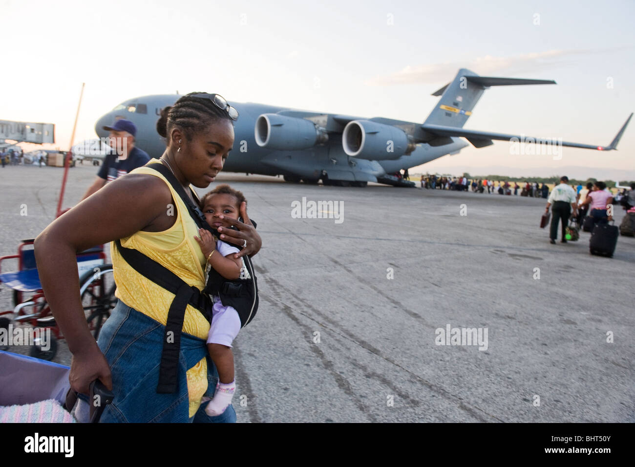 Thousands of US Haitians being evacuated from the islands capital airport after a 7.0 Mw earthquake struck Haiti - Stock Image