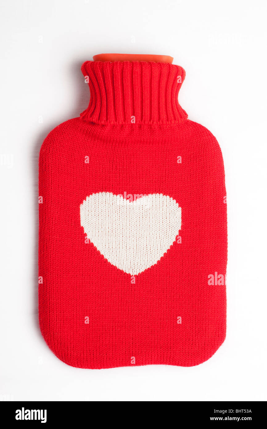 A heart covered hot water bottle - Stock Image