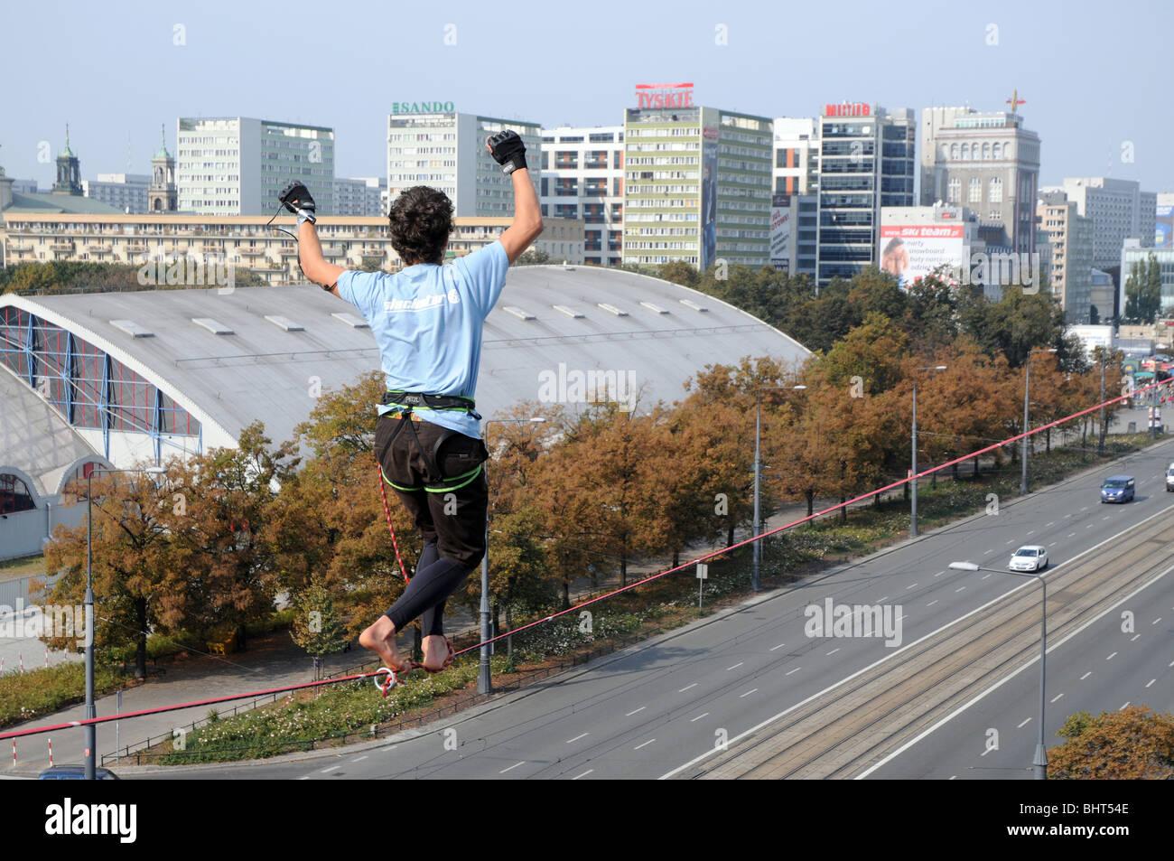 Polish slackliner Jan Galek during show in Warsaw, Poland - Stock Image