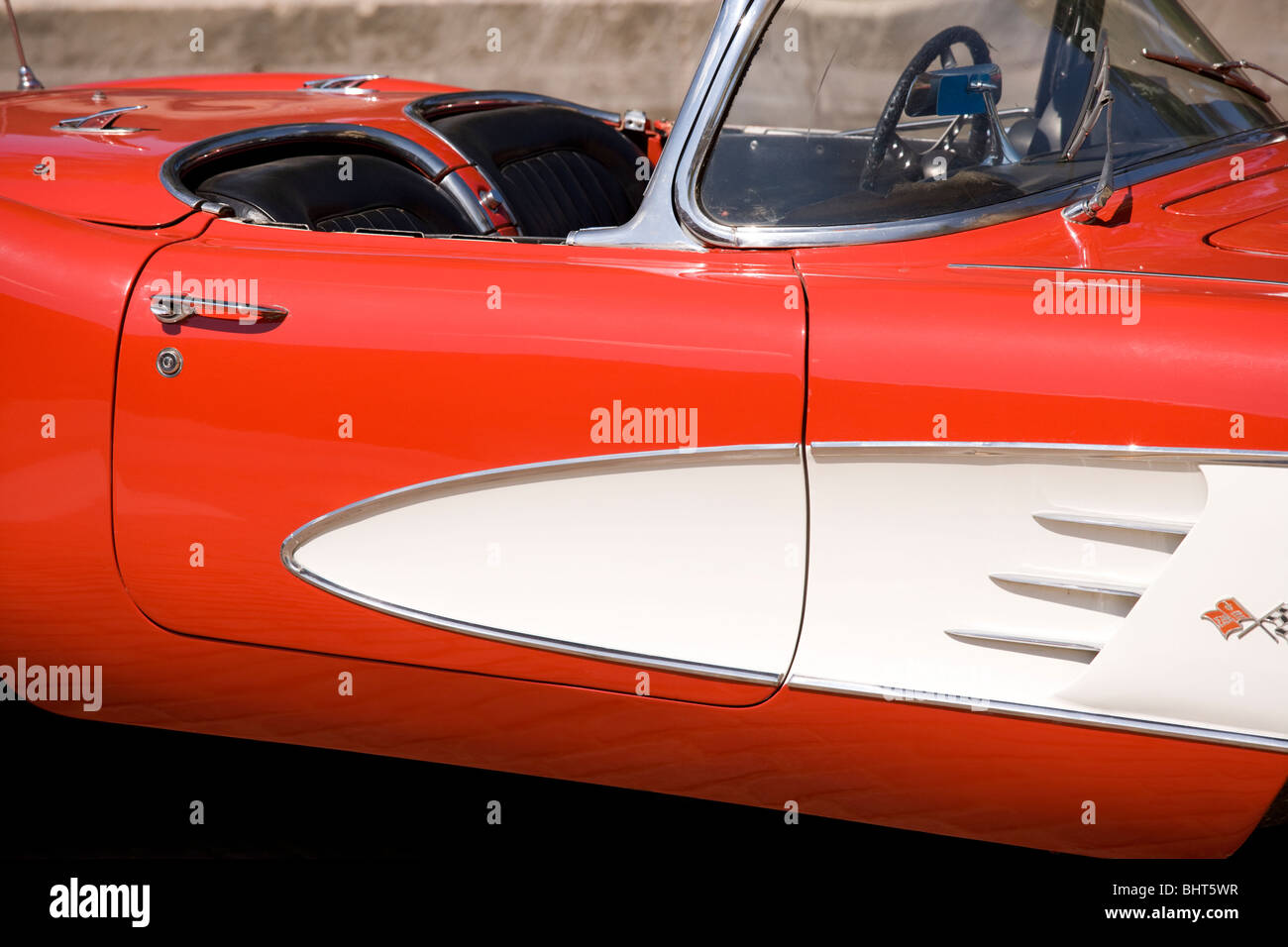 Red vintage Chevrolet Corvette convertible. C1 body from 1958, 59 or 1960. Roman Red with white coves. - Stock Image