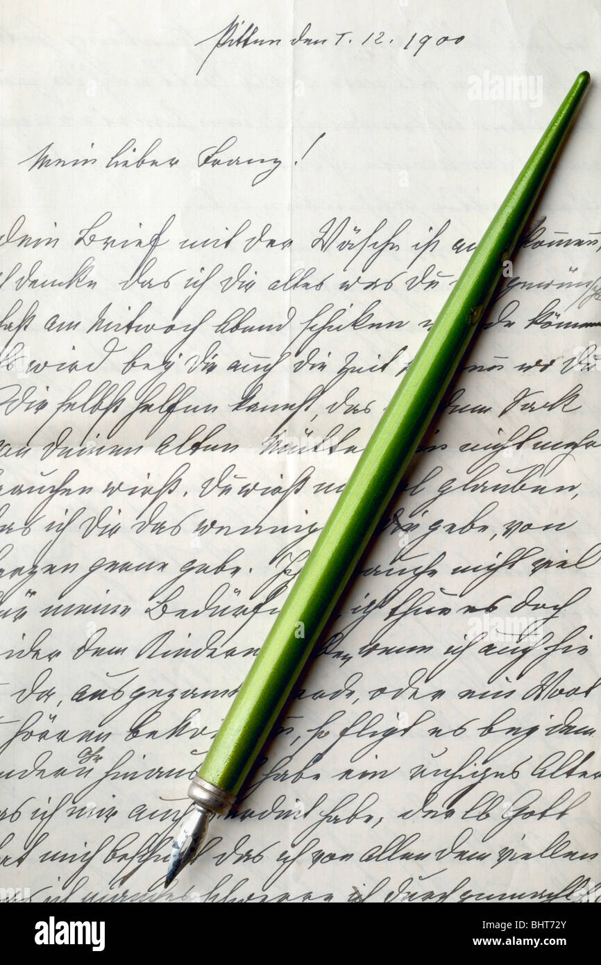 calligraphy pen on a vintage letter - Stock Image