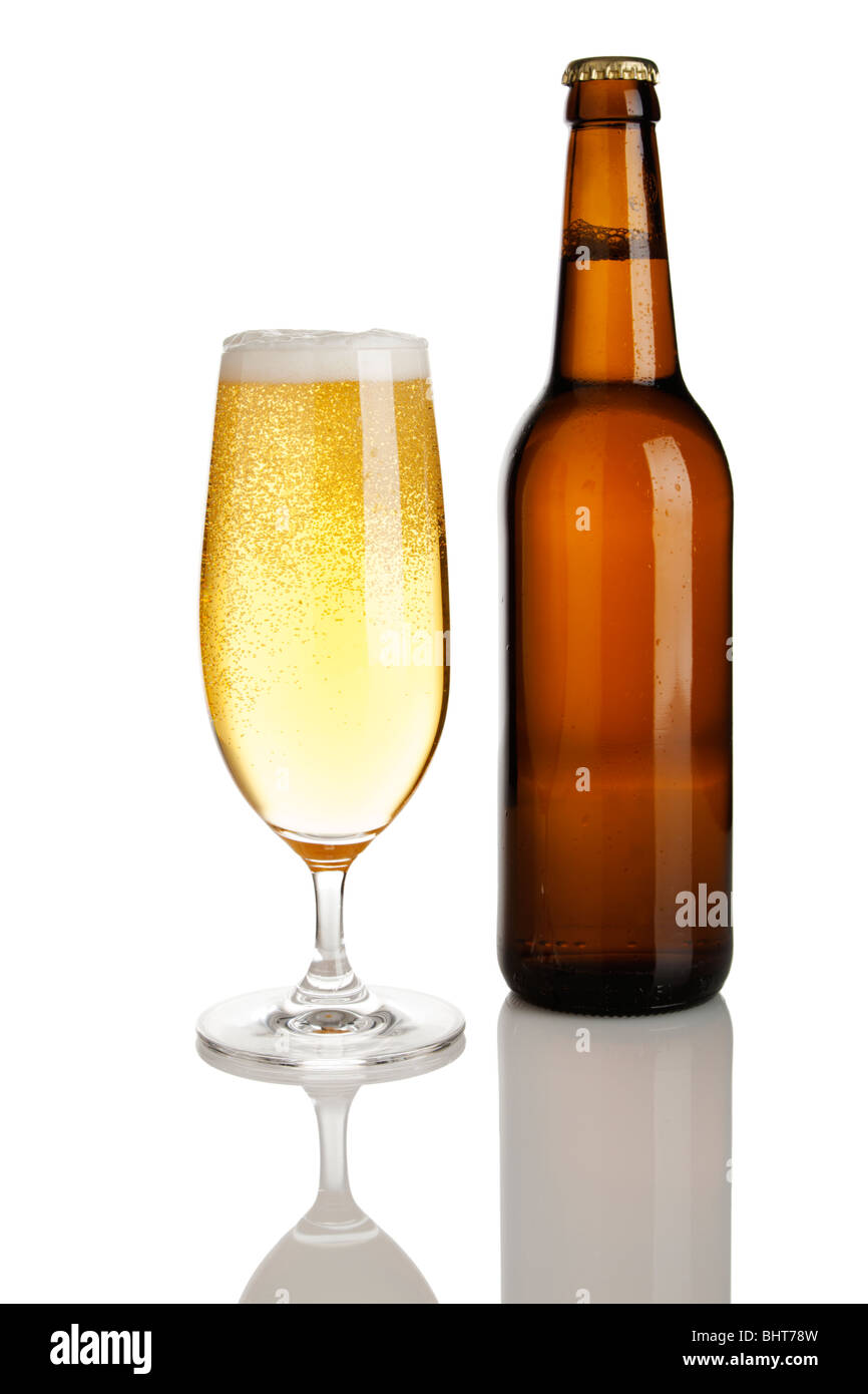 brown bottle without label and glass of lager beer, cutout - Stock Image
