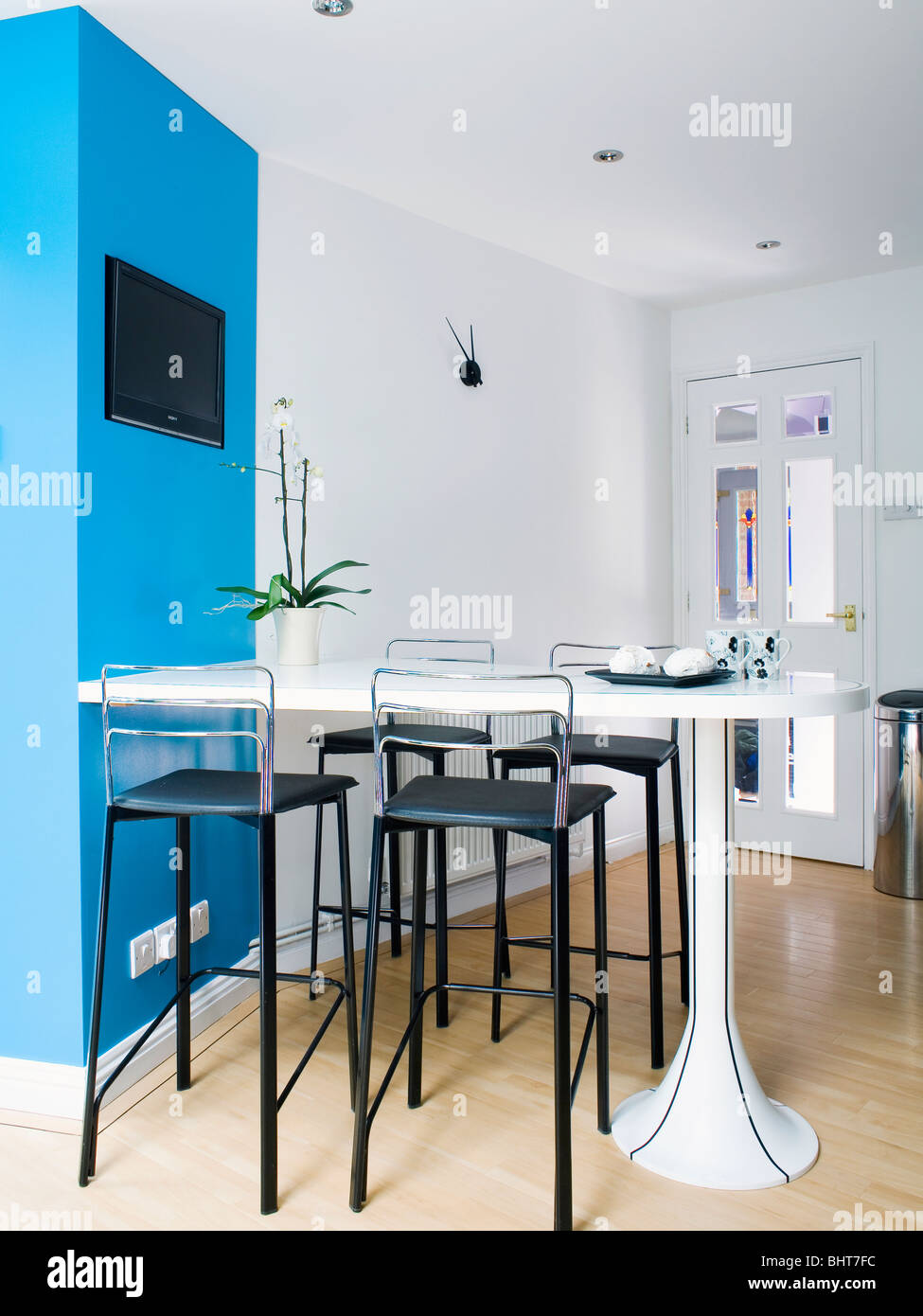 Black stools white breakfast bar in modern white kitchen dining room ...