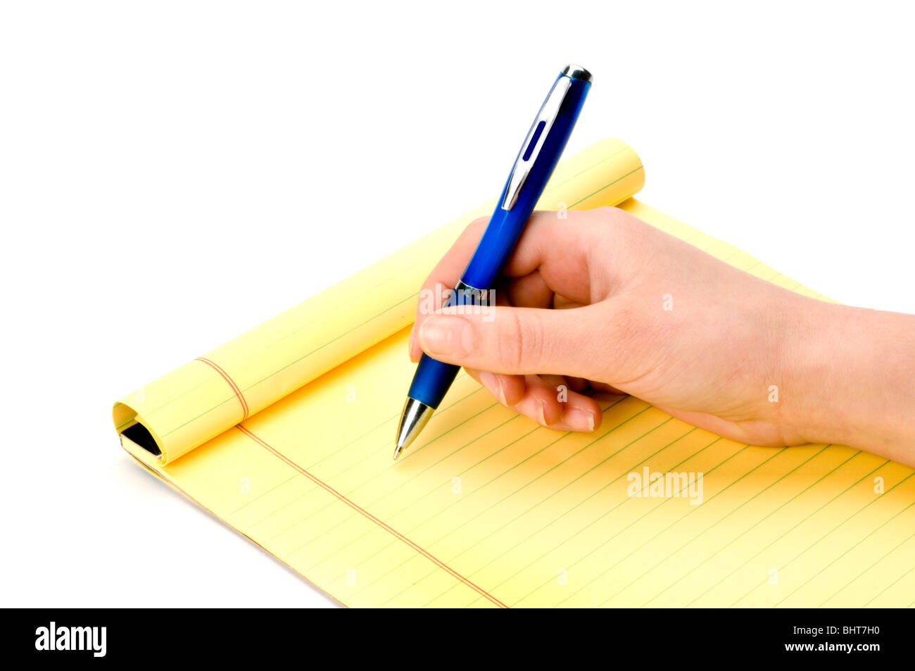 hand on white with pen and pad - Stock Image