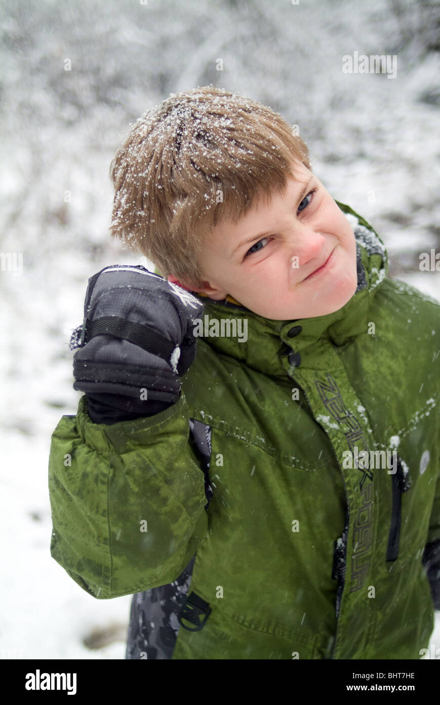 A Child playfully looking angry shaking his fist at camera - Stock Image