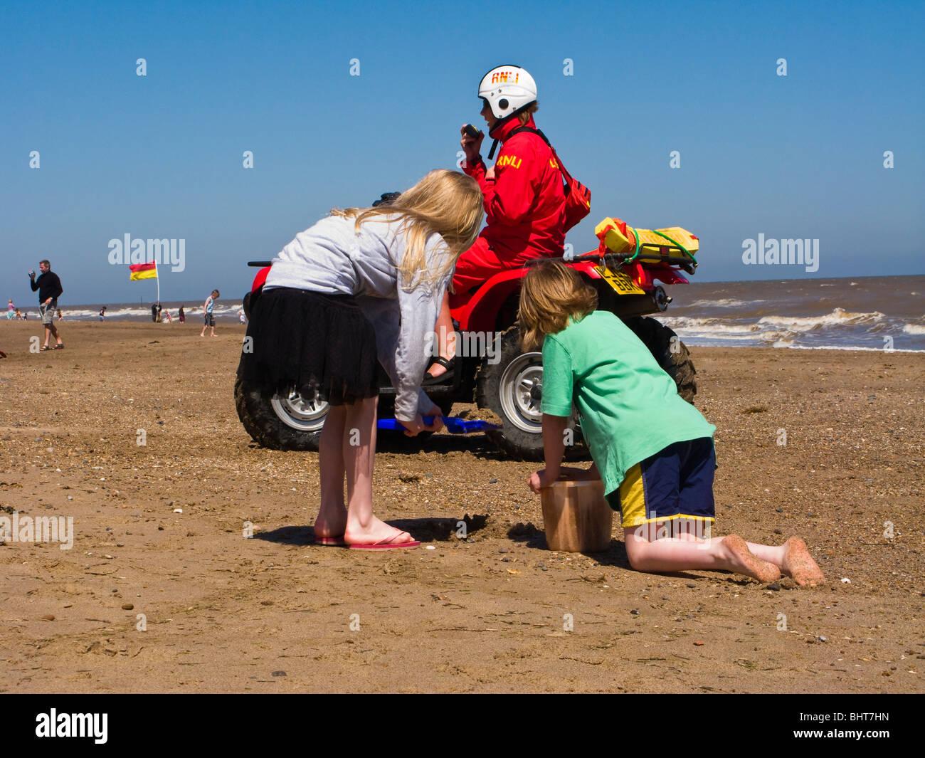 436348b7081 Lifeguard Beach Children Stock Photos   Lifeguard Beach Children ...