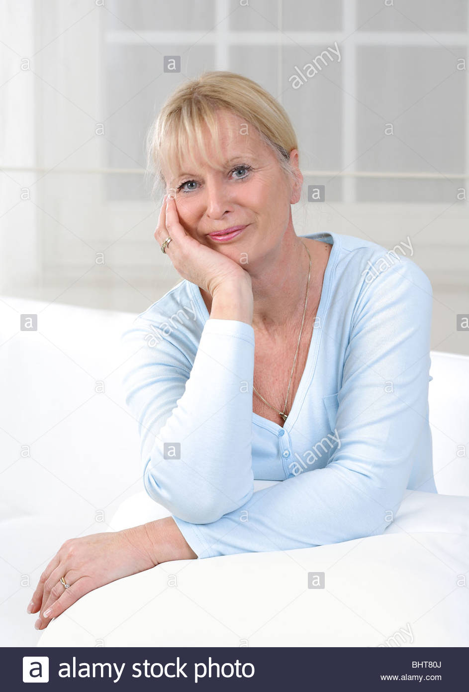 middle aged woman thinking about problems Stock Photo