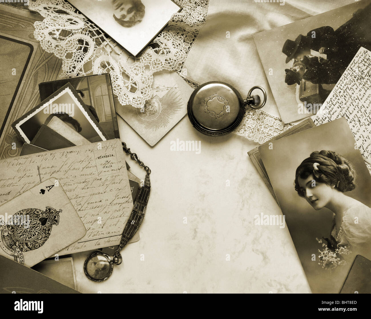 Memories in sepia. Composition of vintage photographs and other objects. - Stock Image
